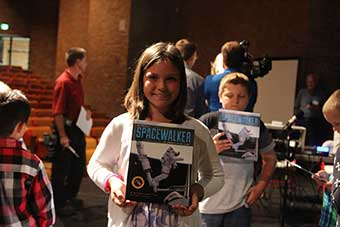 Student with Spacewalker book