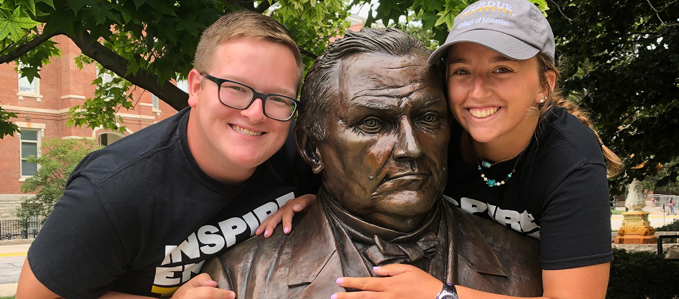 Students with John Purdue Statue